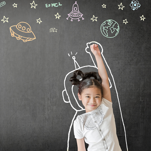 Young girl imagining being an astronaut